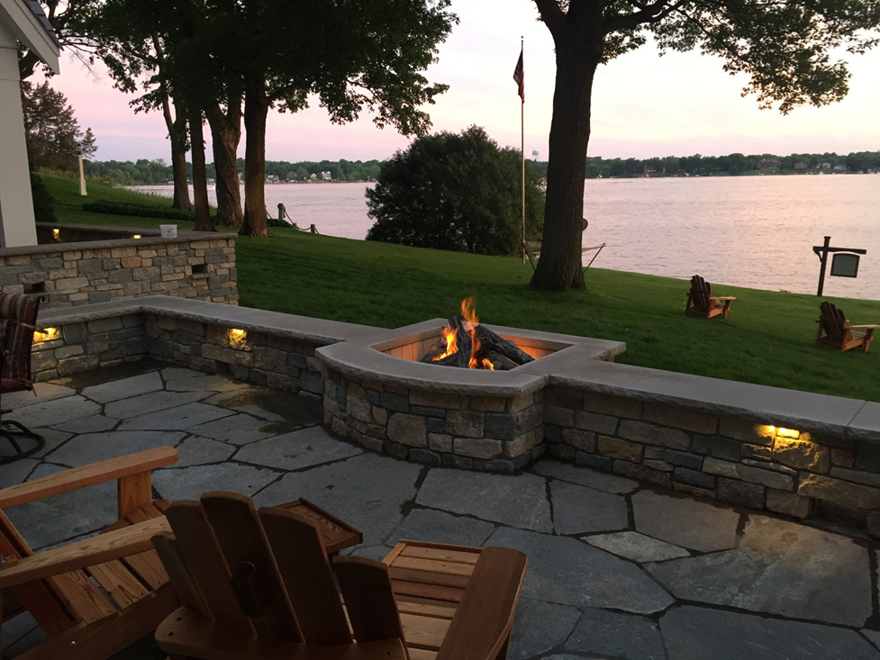 Relaxing Space on the Lake with Mortarted Wall and Fire Pit and Limestone Patio.