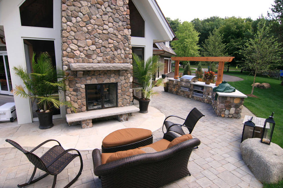 This was Built as an Extension to the Homeowners Screen Porch. Custom Fireplace, Outdoor Kitchen and Paver Patio
