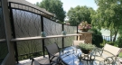 Custom Metal Trellis with Acrylic to Screen Deck Area
