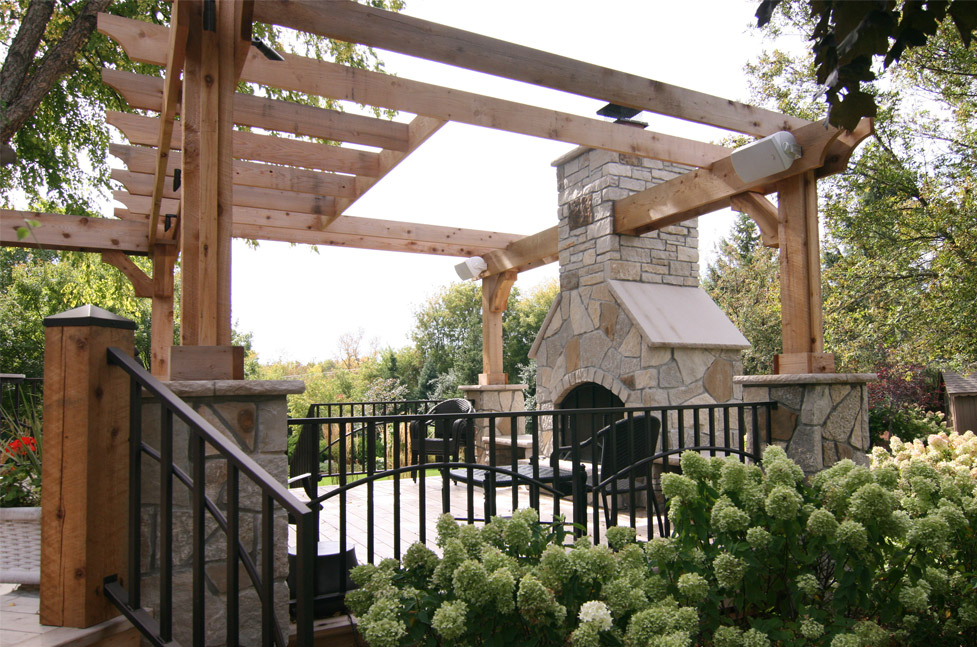 Limestone Mortared Wood Fireplace, Cedar wood Pergola with Limestone Pillars