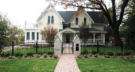Historic Stillwater Minnesota Home Restored with a Cobblestone Paver Walkway and Custom Metal Gate and Curved Fence