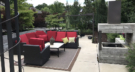 Modern Industrial Entertaining with Concrete Fireplace Concrete Patio and Metal Arbor