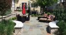 Small Bluestone Backyard with Raised Limestone Seated Walls
