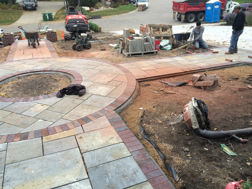 Finishing Installation of the Clay Paver Border in Bloomington, MN