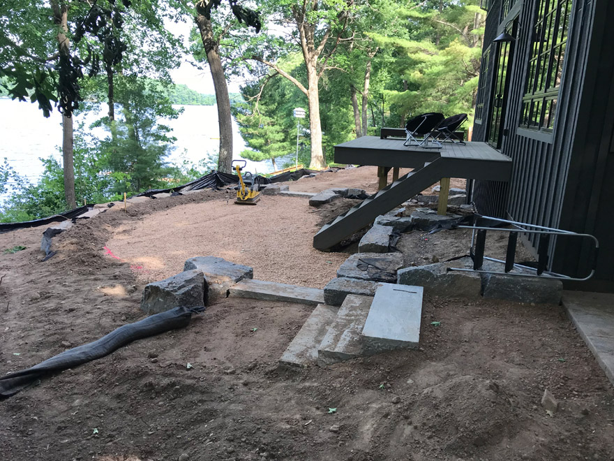 Compacting the Rock Base for the Bluestone Patio Installation
