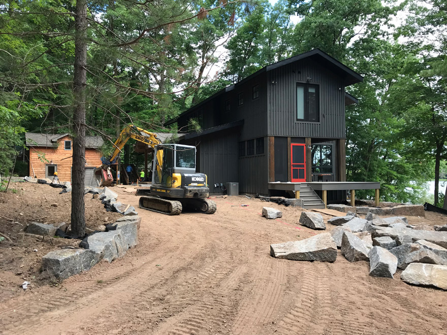 Cumberland, WI Modern Cabin installing Charcoal Granite Cubes
