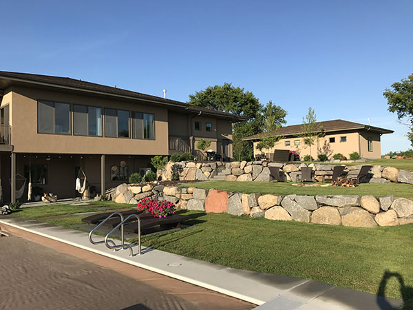 Boulder retaining wall to create two levels of entertaining
