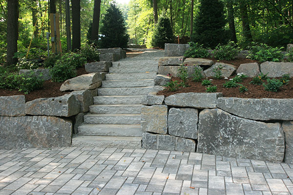 Completed Wisconsin Lake cabin driveway with permeable pavers, granite walls, and bluestone steps