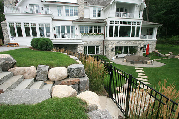 Lake Minnetonka Wayzata Minnesota new construction home with boulder retaining wall and bluestone steps to pool