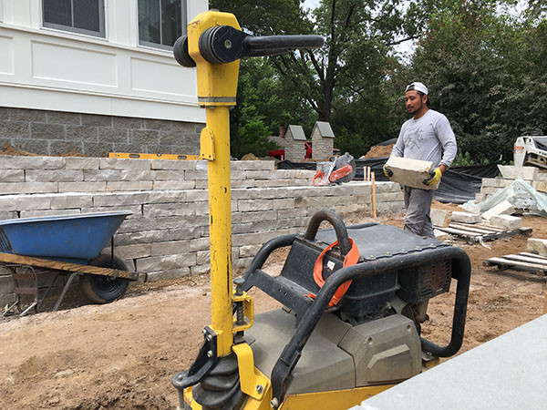 Stillwater Minnesota St. Croix River historic home installing cute limestone walls for clean line