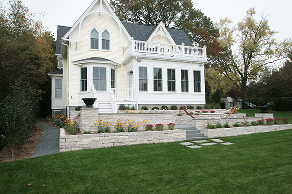 Stillwater minnesota home with a natural limestone walls with a bluestone cap for sitting
