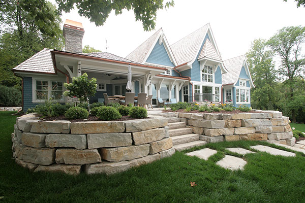Wayzata Minnesota Egg Shell Blue cottage with large limestone slab walls
