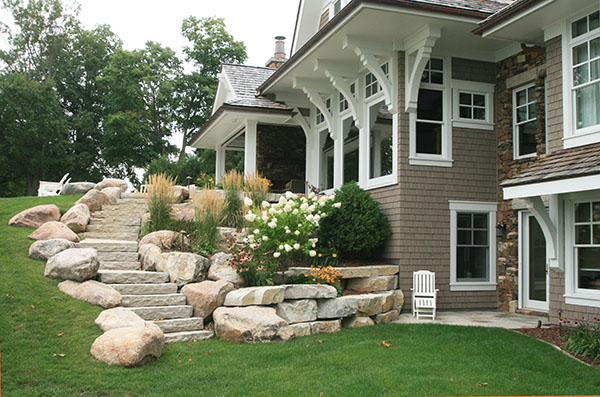 combination of boulders and limestone for this staircase and retaining walls