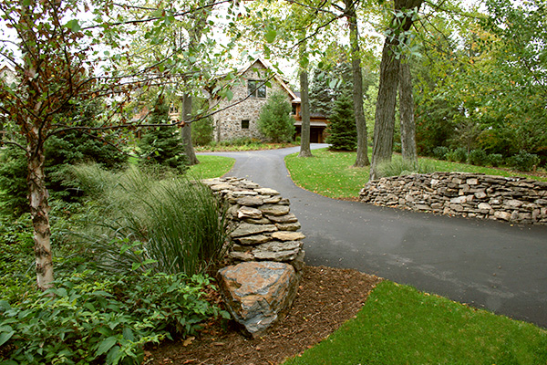 Orono Minnesota Asphalt Driveway with a Dry-Stacked Wall