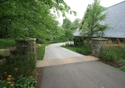 Mixed Material Driveway with Asphalt, Concrete, and a Paver Apron