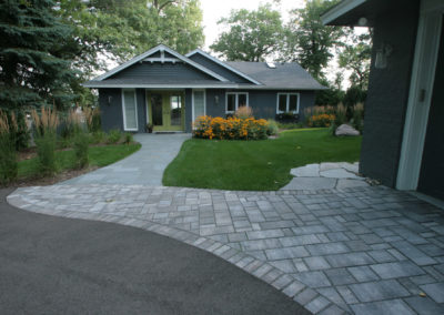 Mixed Material Driveway with Asphalt and Paver Details