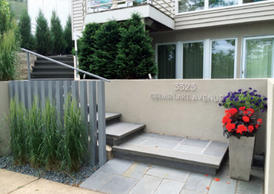 Modern Cedar Lake Front Entry with Custom Metal Fencing and Railing