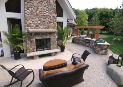 Mortared River Rock Fireplace and Outdoor Kitchen with Flagstone and Paver Patio