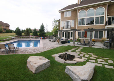Custom Backyard Swimming Pool and Fire Pit