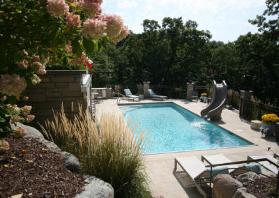 Custom Concrete In-Ground Swimming Pool with Travertine Patio in Edina, MN