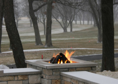 Custom Gas Firepit Integrated into Wall Seating