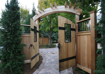 Custom Metal Details in a Cedar Fence and Gate