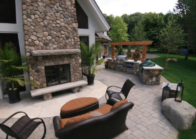 River Rock and Limestone Outdoor Kitchen Overlooking Lake Minnetonka, MN