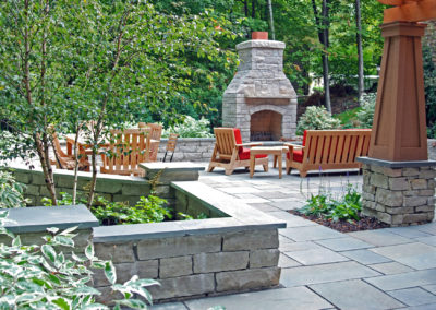 Bluestone Patio with Limestone Walls and Fireplace
