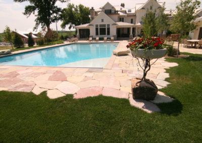 Custom Concrete Pool and Limestone Patio