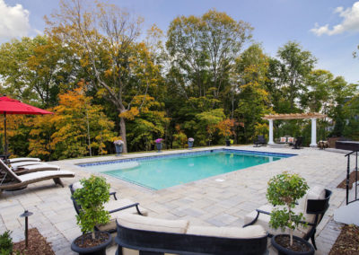 Concrete Swimming Pool with Sundeck and Paver Patio