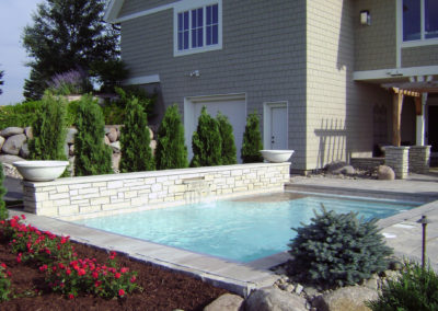 Custom Concrete Swimming Pool with Sundeck and Water Feature