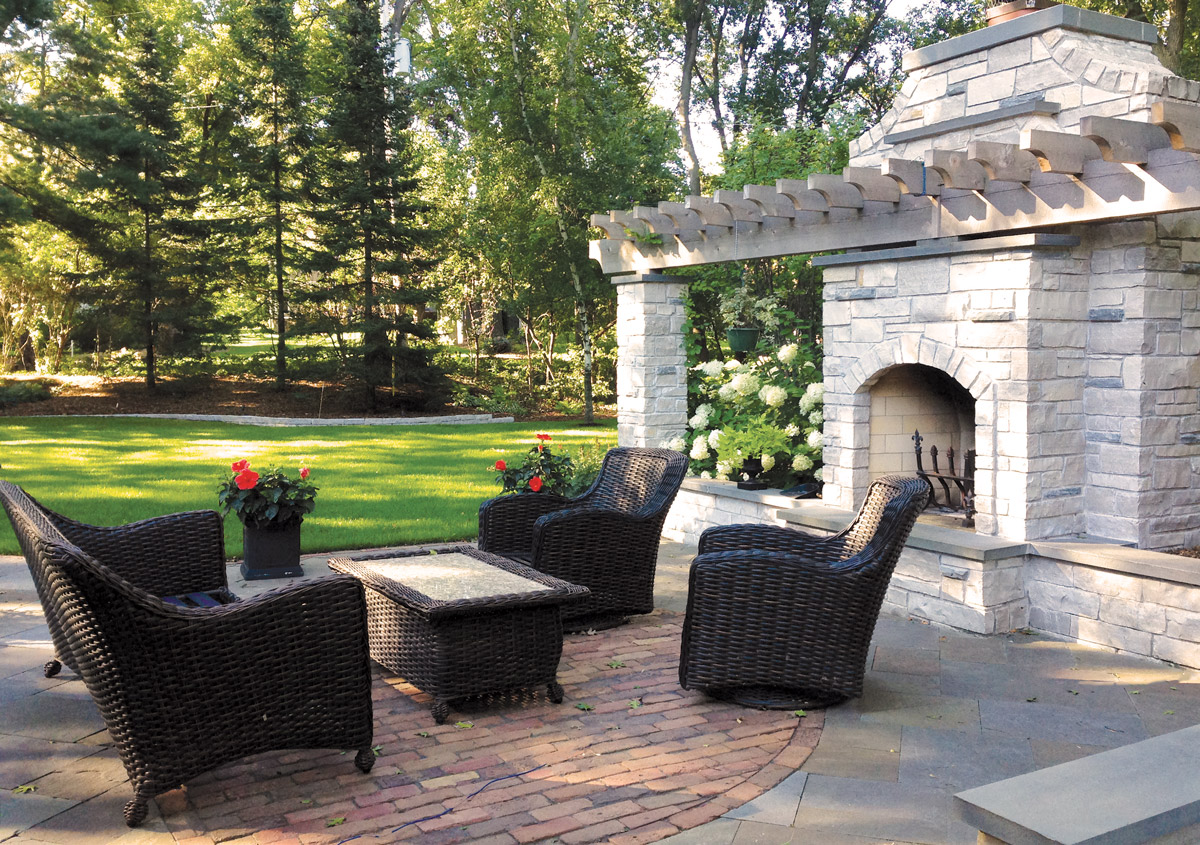 Edina-Mn-home-with-wood-burning-fireplace-on-limestone-and-paver-patio