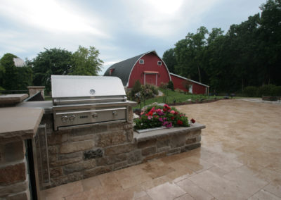 Small Grill and Prep Area with Planter Mortared in Limestone