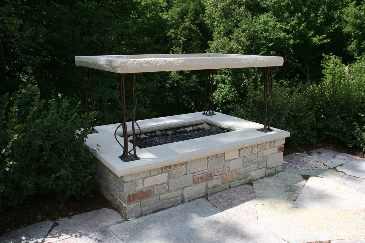 Free-standing-gas-fire-feature-with-custom-metal-stone-arbor