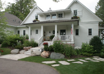 Coastal Cottage Architecture on Lake Minnetonka with Limestone Walkway and Metal Railings