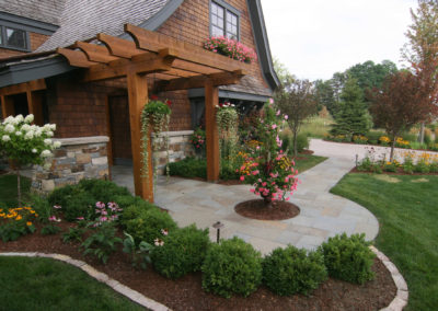 Circular Bluestone Walkway and Cedar Arbor with Varied Plantings