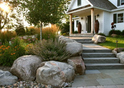 Remodeled Farmhouse in Prior Lake, MN with Boulder Accents, and a Mix of Bluestone and Limestone Front Entry