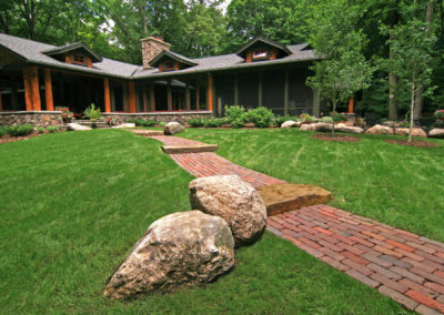 Wooded Front Entry with Boulder Outcroppings, Paver and Limestone Walkway