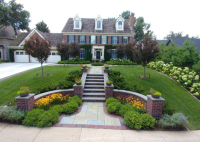 Traditional Front Entry Remodel with Bluestone Walkway, Paver Border, and Brick Mortared Walls