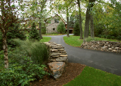 Dry-Stacked Entrance Walls with Natural Plantings