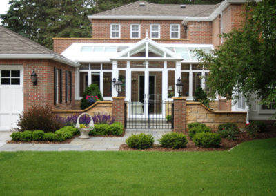 Front Entry Conservatory Addition and Mortared Limestone Walls and Brick Pillars
