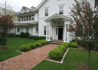 New Build Colonial with Weathered Cobblestone Front Entrance Pavers and Minimal Plantings