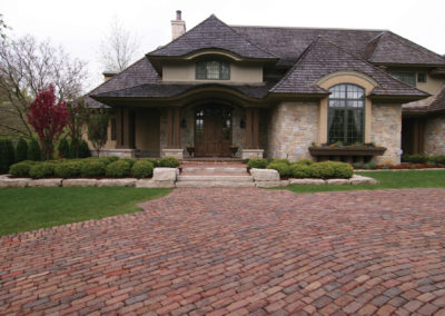Front Entry with Cobblestone Pavers and Limestone Retaining Walls in Edina, MN