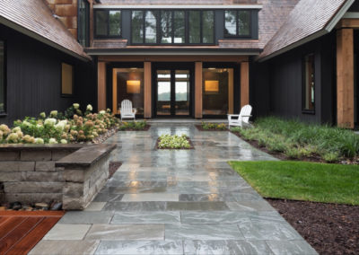 Modern New Build Front Entry with Elements of Bluestone, Limestone, and Wood