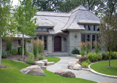 Front Entry with Boulder Outcroppings and Bluestone Walkway