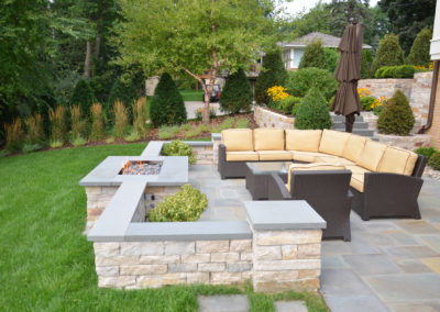 Limestone Seating Wall with Bluestone Top, Gas Fire Pit, and Bluestone Patio in Edina, MN