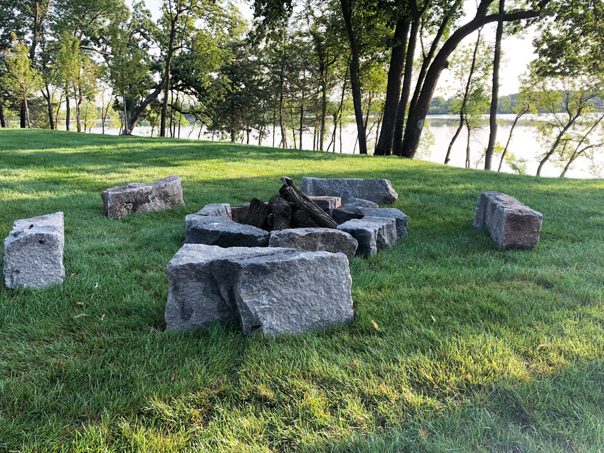 Granite-stone-fire-feature-overlooking-the-lake