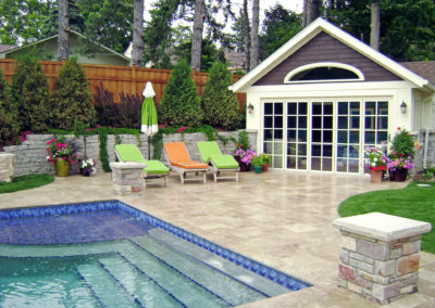 Custom Concrete Swimming Pool with Sundeck and Travertine Water Feature