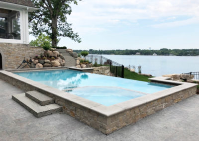 Custom Concrete Vanishing Edge Pool with Spa Inset on Prior Lake