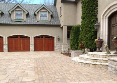 Auto-Court Driveway with a Variety of Pavers and Textures